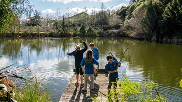 Families find many fun activities within the park - making dens, rafts, and fishing rods out of natural materials.