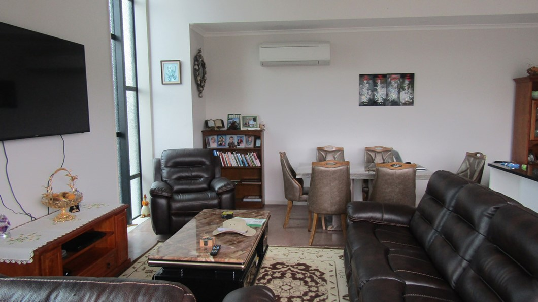 Lounge and dining area.  Comfortable lounge for guests with 65 in flat screen TV