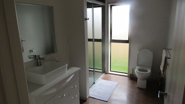 Shared bathroom with walk in shower, hair dryer