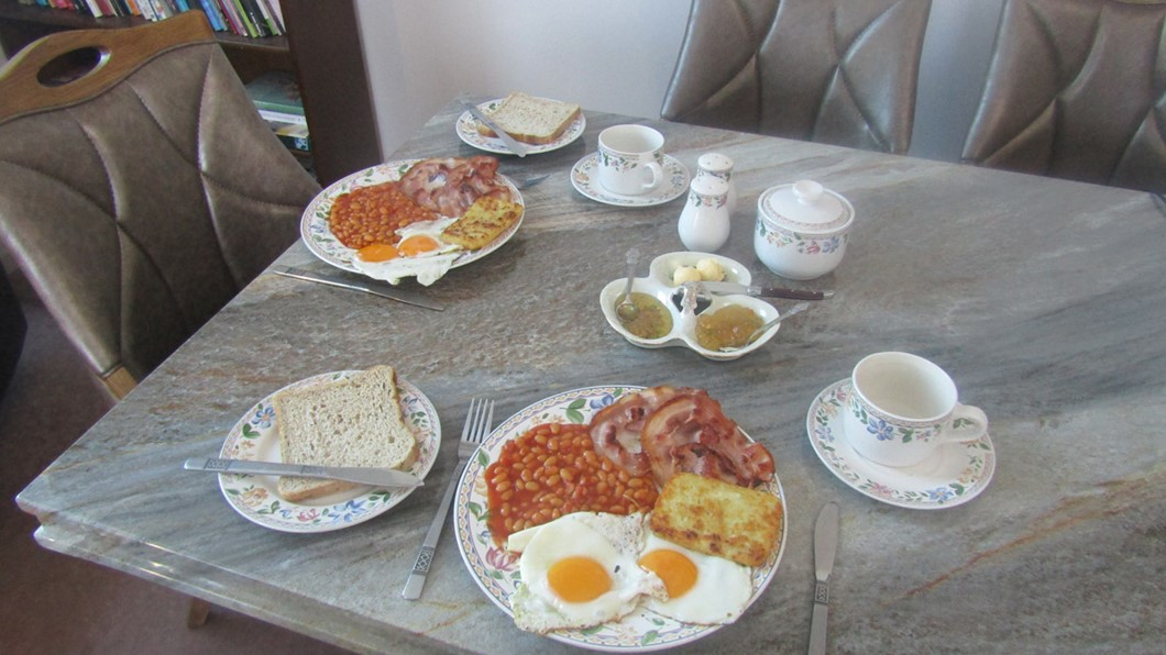 A hearty hot breakfast. Great hot breakfast to start the day bacon, eggs, hash brown with toast and coffee/ tea