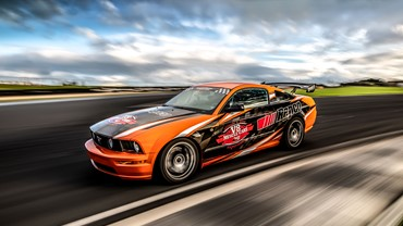 Take your turn behind the wheel of the Repco 5L V8 production-based Mustang race car. Our professional driver will guide you through 5 laps teaching you the 'racing line' and help guide you through an adrenalin-filled experience.
