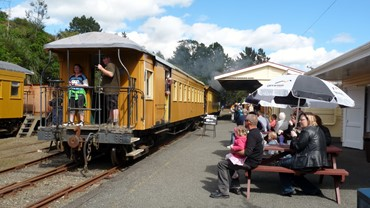 Passengers at tables on a sunny Open Day