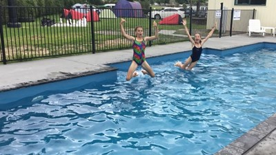Kids having fun in the pool.