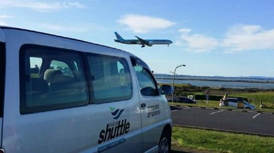 Raglan Shuttle waiting for flights to arrive at Auckland International Airport